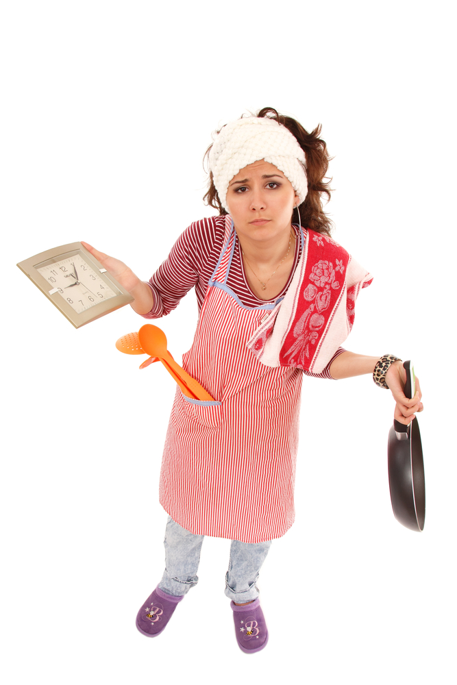 Woman getting stressed in the kitchen