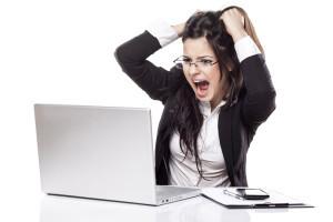 woman screaming at computer