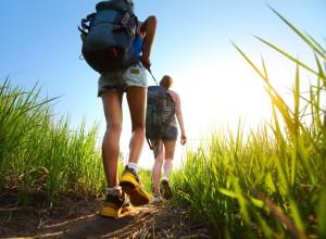 Girls with backpacks hiking