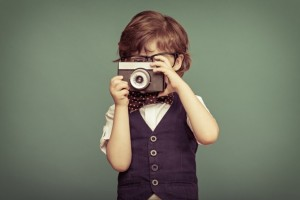 child taking picture
