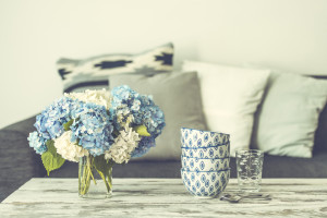 flowers and bowls on table