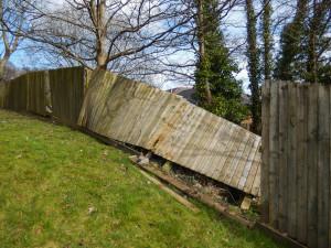 broken fence after storm